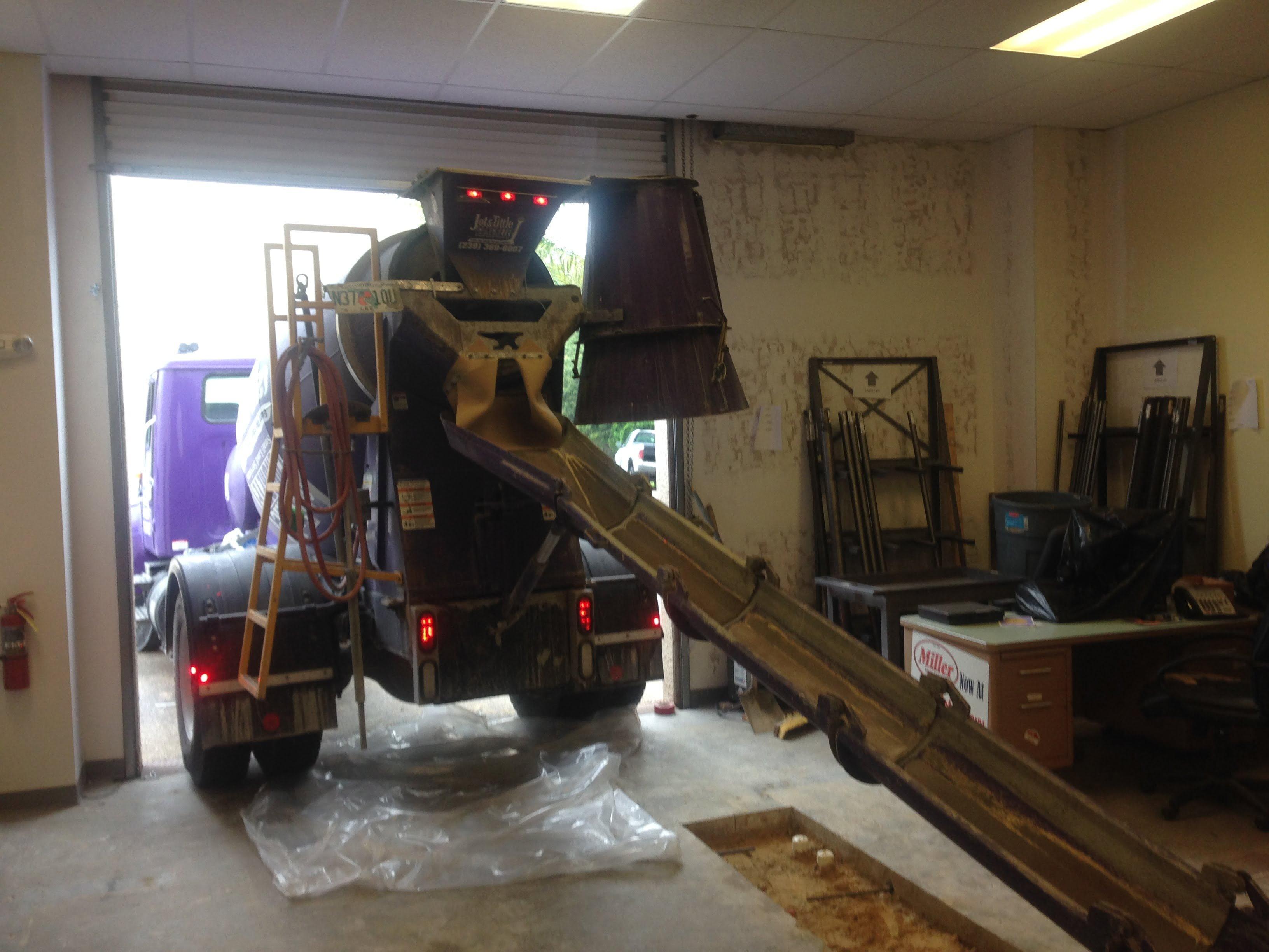 jot and tittle truck under building