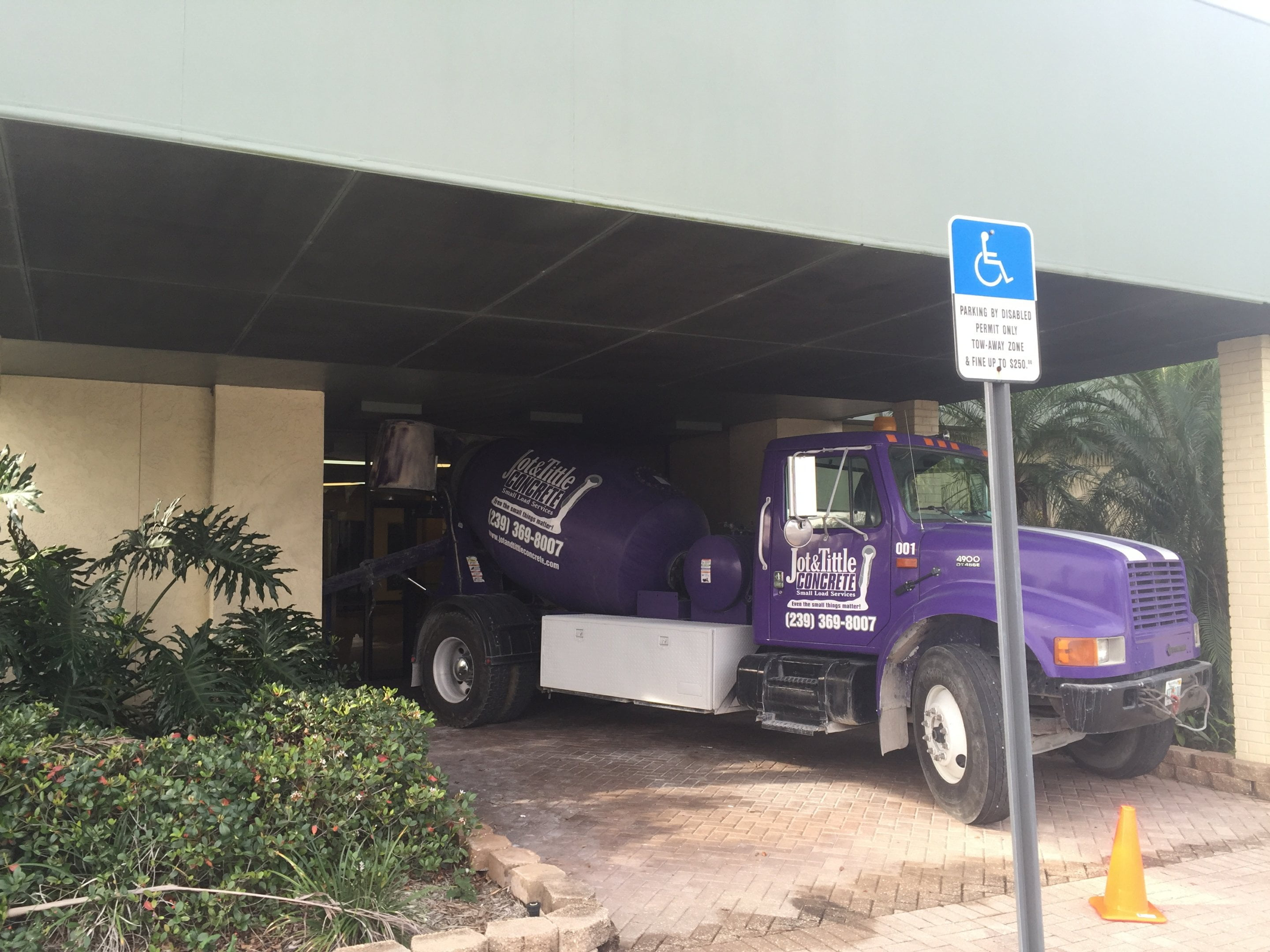 jot and tittle truck under building